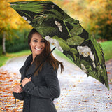 White orchid flower tropical leaves pattern blackground Umbrella