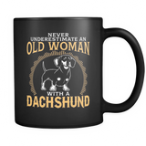 Black Mug-Never Underestimate an Old Woman With a Dachshund ccnc003 dg0050