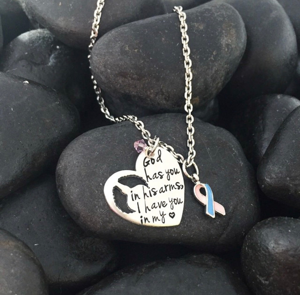 GOD HAS YOU IN HIS ARMS HEART NECKLACE