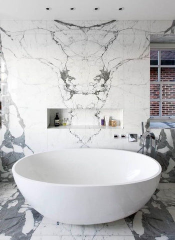 Bathroom Style — Combination of marble, neutral tones and luxe baths and basins.