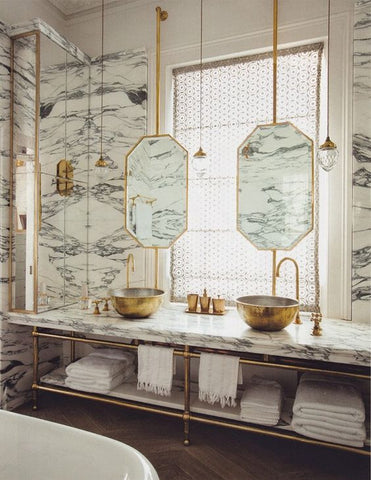 Spanish-inspired Marble Bathrooms using marble gold