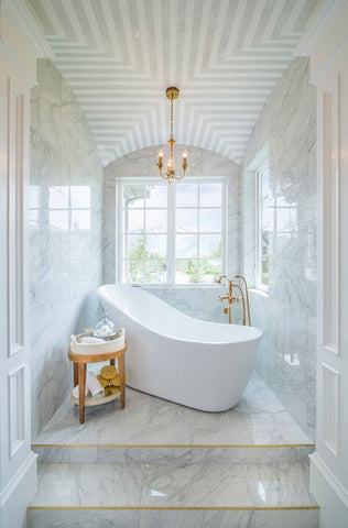 White Bathroom with Gold Side Table and Lights