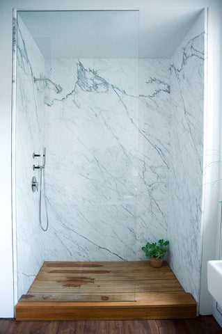Marble Shower with Wood-material Flooring