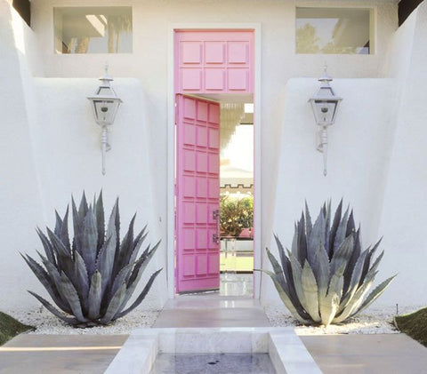 White house with Palm Springs Exterior Using Pastel Pink Door