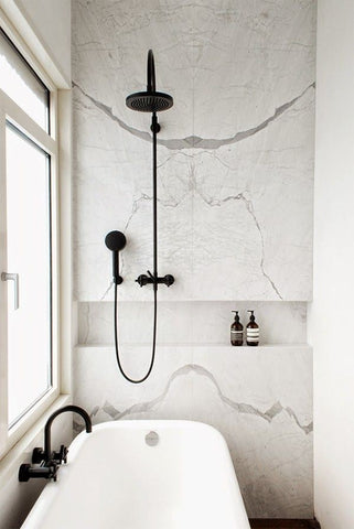 White Marble Bathroom with White Bathtub