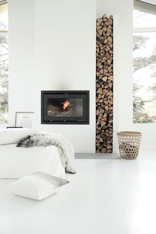 All white bedroom interiors with modern fireplace