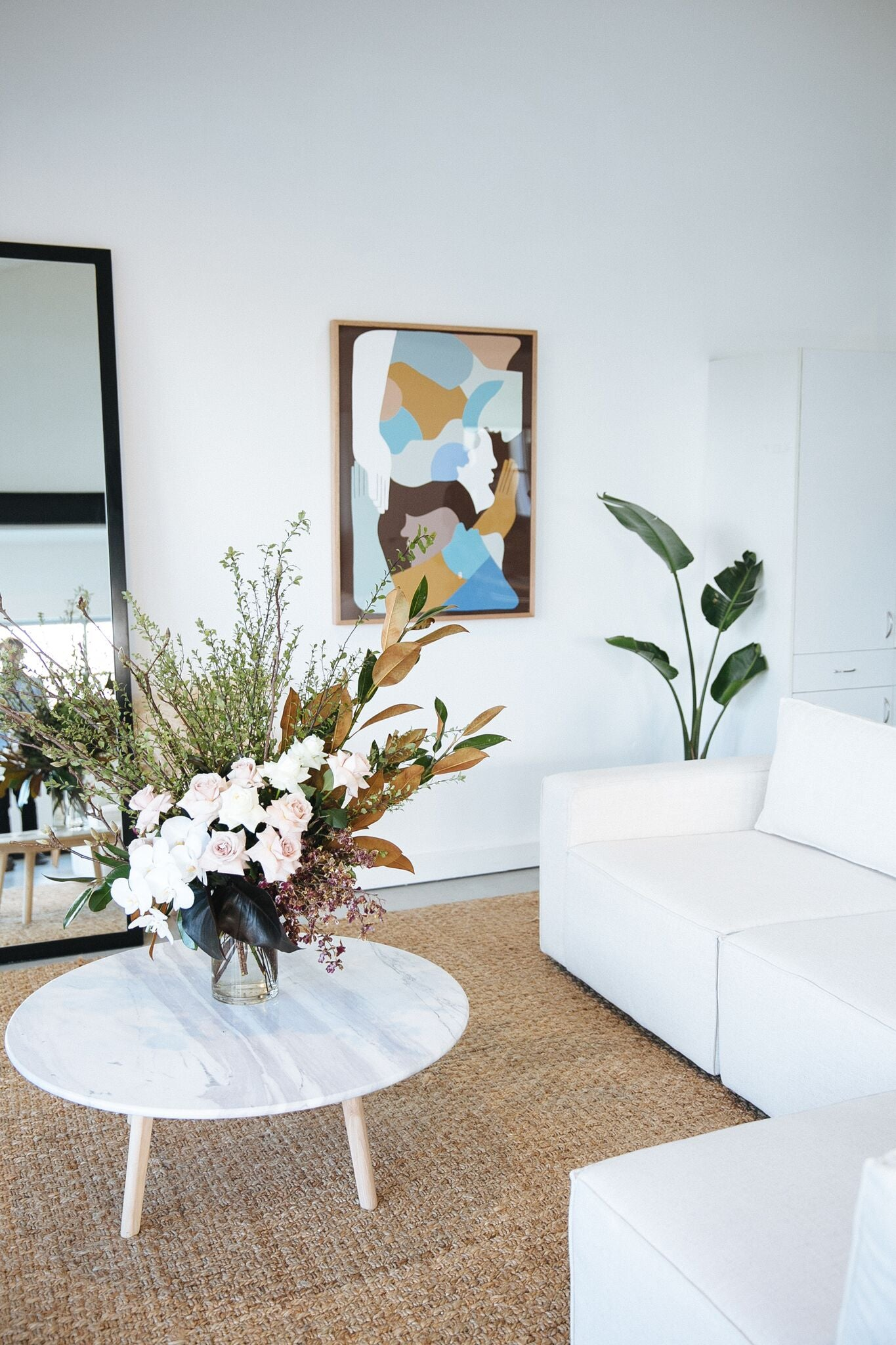 White Living Room with A Pop of Bright Pastel-Coloured Acrylic Artwork