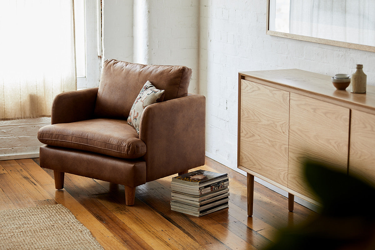 Brown Chester Timber Armchair next to a timber side board