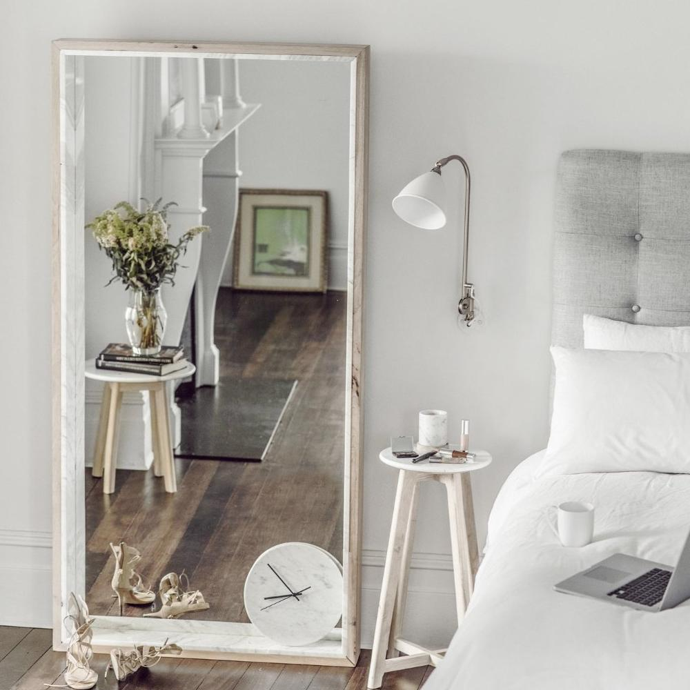 Marble & Timber Floor Mirror in a Bedroom With Side Marble Table