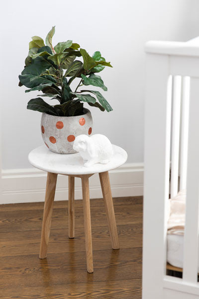 Round Marble Side Table With Green Plant as a pop of colour