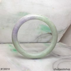 Upper arm light green with splotches lavender jade bangle