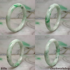 White base with green splotches jade bangle