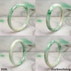 Small white base with splotches green jade bangle