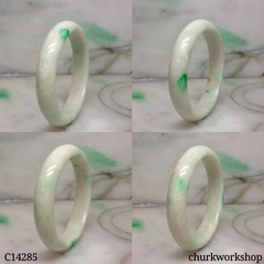 White base with splotches apple green jade bangle