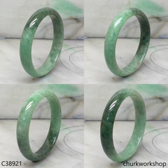 Small green base with splotches bluish green jade bangle