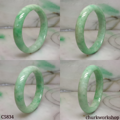 Small light apple green jade oval bangle