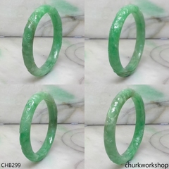 Small carved green jade bangle