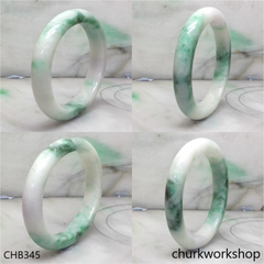 White base with green splotches oval jade bangle