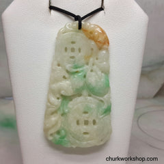 Carved jade pendant.