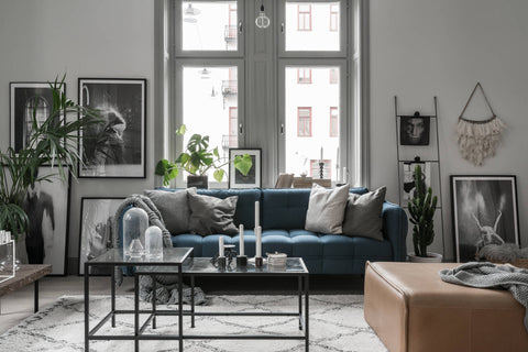 Blue Sofa in Beautiful Stockholm Apartment in Soft Greys