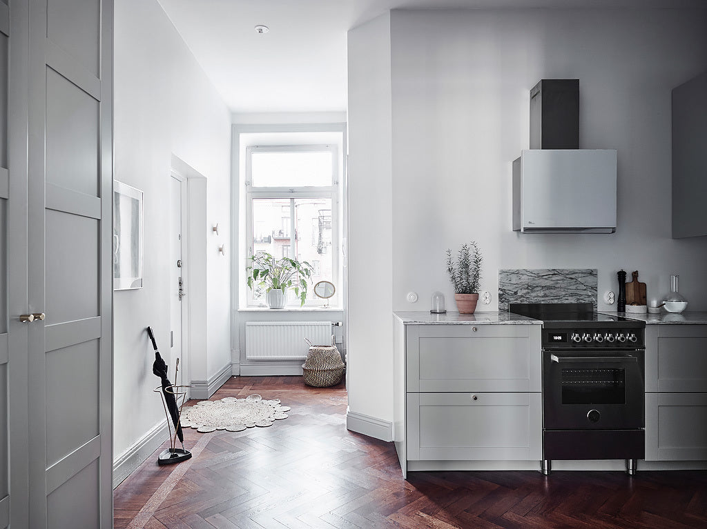 Entryway in Swedish Apartment with Light Grey Cabinets