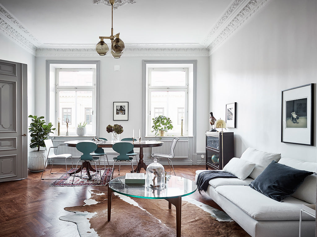 LIving + Dining Area of Stunning Swedish Apartment with Green Accents
