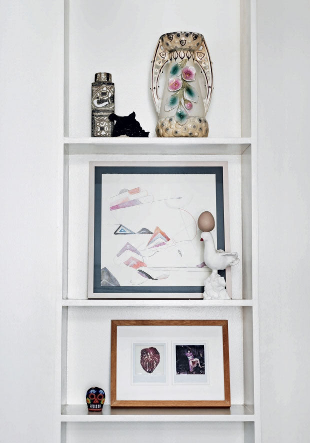 A well curated shelf in the home of Danish fashion designer Heidi Hofmann
