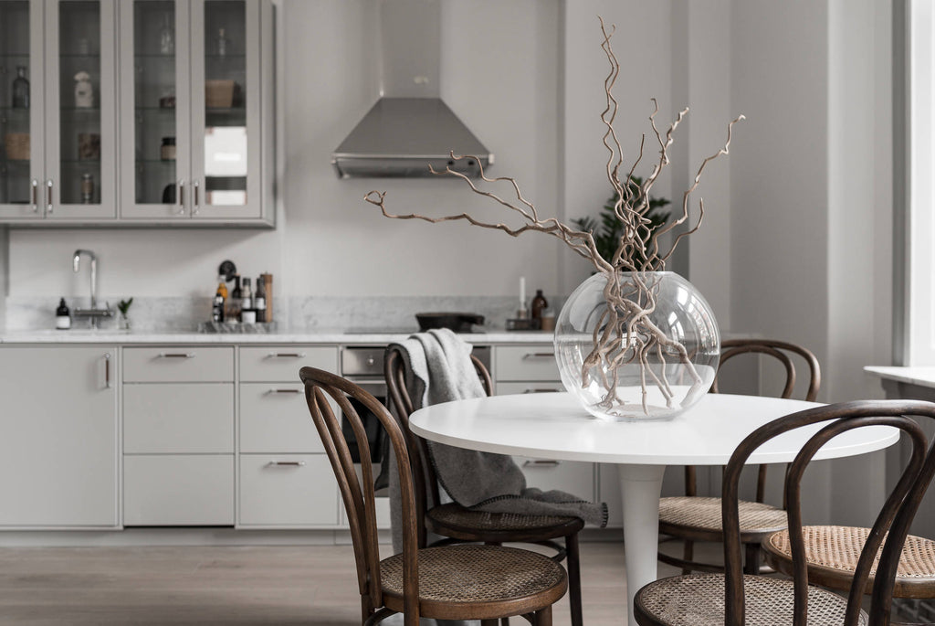 Dining area in Swedish Apartment with Soft Greys