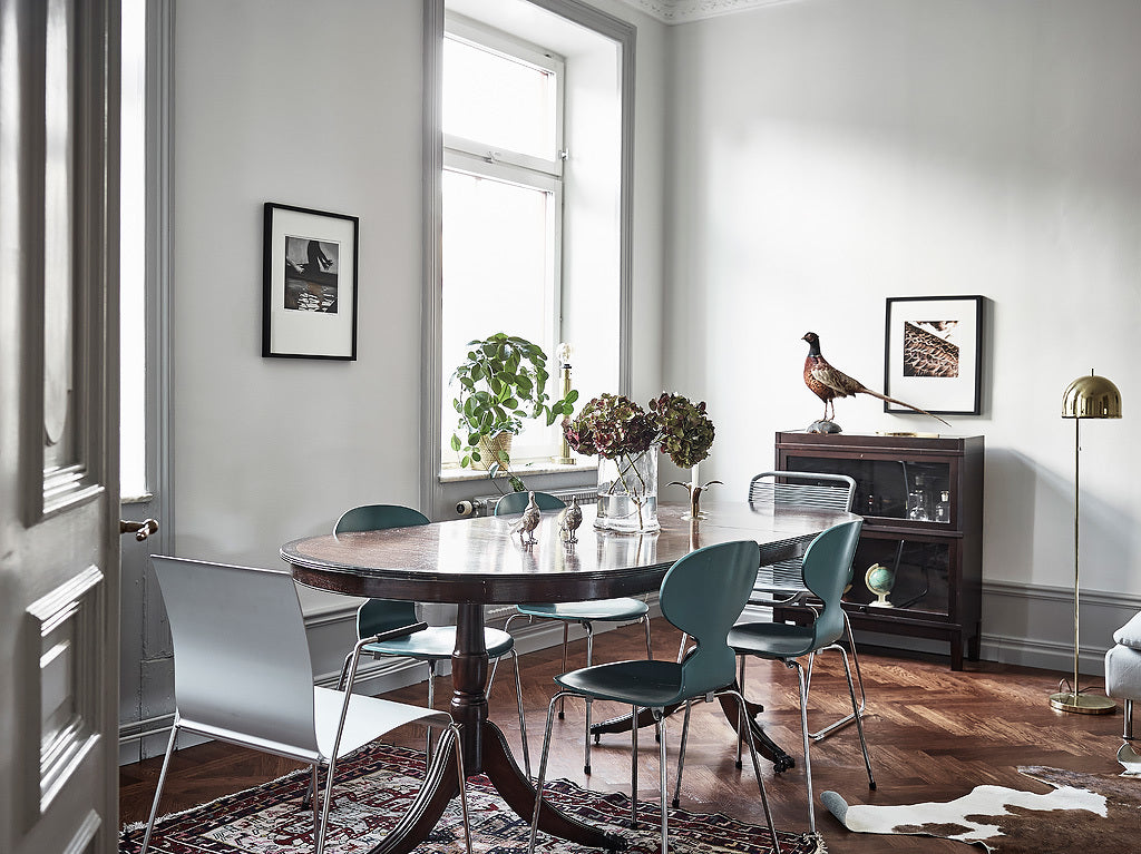 Dinning are in Stunning Swedish Apartment with Green Accents
