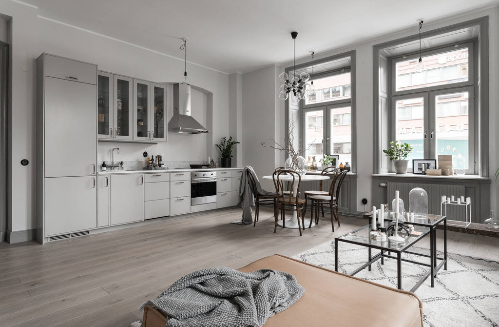 Kitchen and Dining Area of Stockholm Apartment in Soft Greys