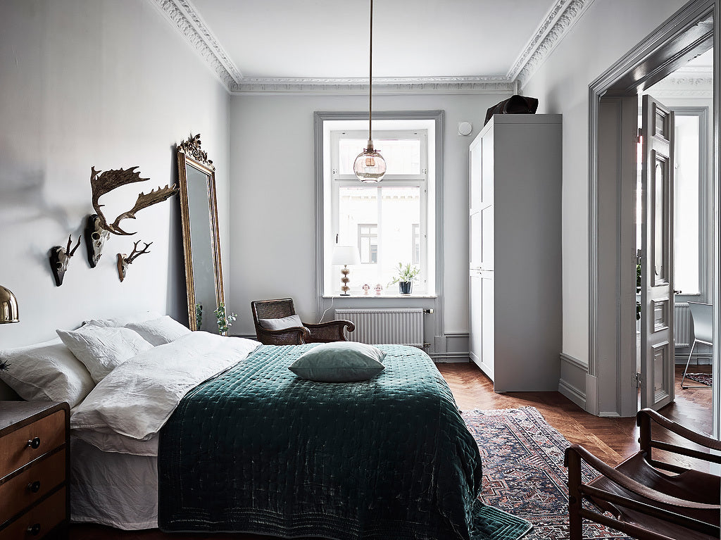 Bedroom in Stunning Swedish Apartment with Emerald Green Accents