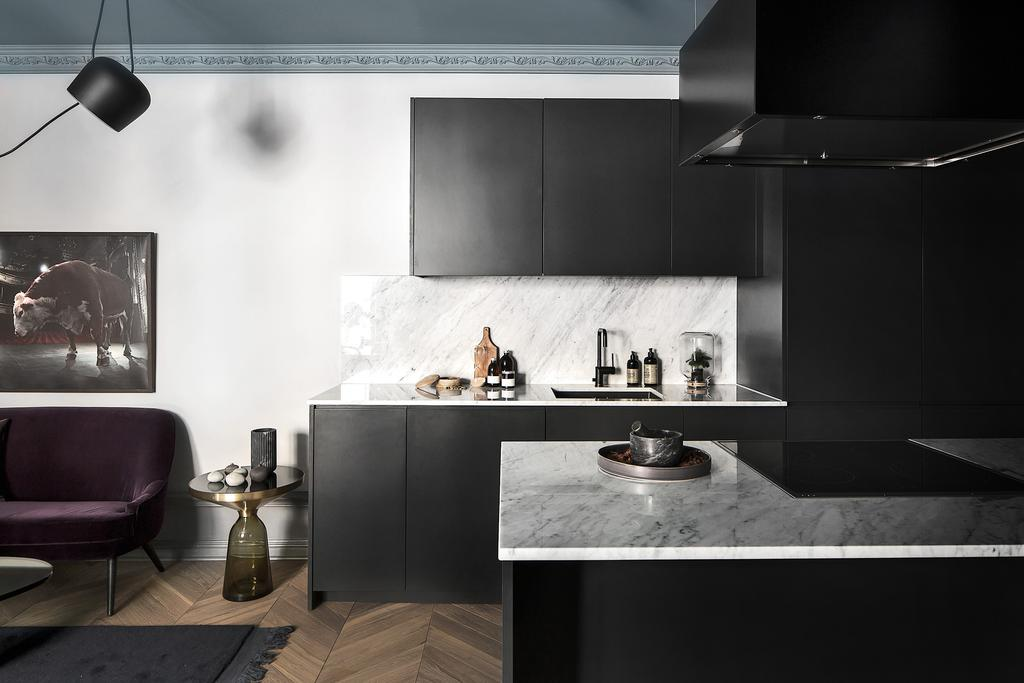 Gorgeous black kitchen cabinets in Stockholm apartment