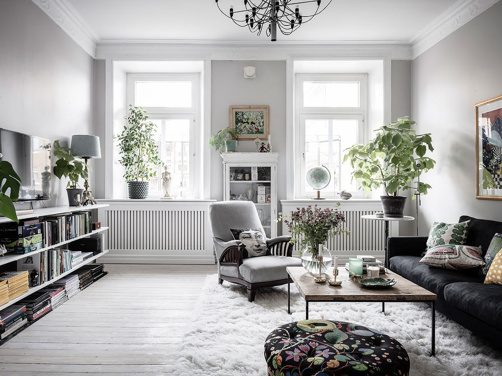 Living room in Swedish home with lots of colour