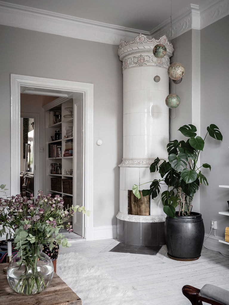 Swedish living room with beautiful white tile stove