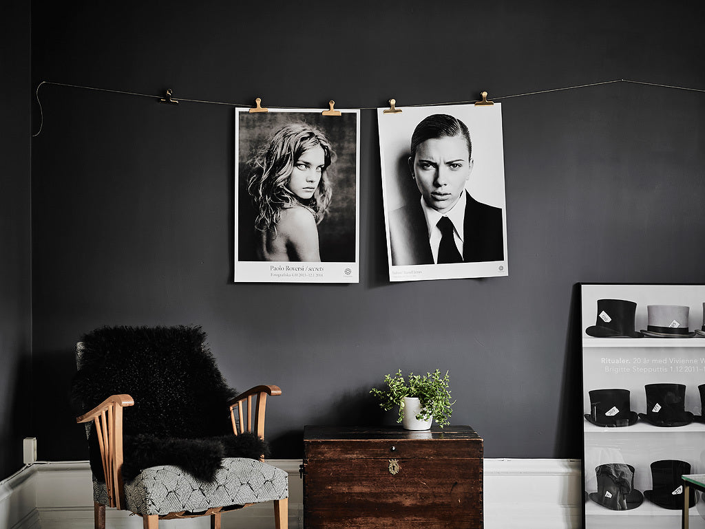 Lovely way to hang a print in Gothenburg apartment with stunning dark walls