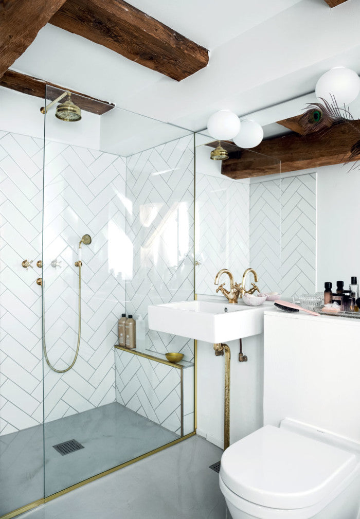 Herringbone tile bathroom in Christianhavn apartment