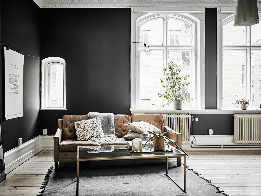 Living are in Gothenburg apartment with stunning dark walls