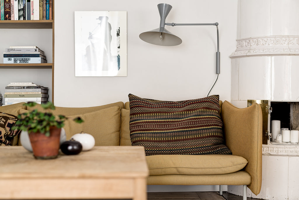 Cosy yellow sofa in Swedish apartment
