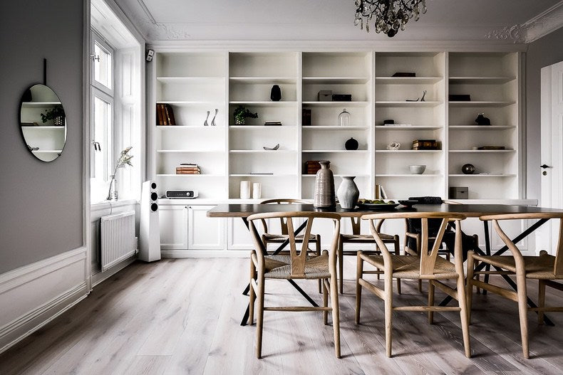Swedish style dining room with wall of shelves