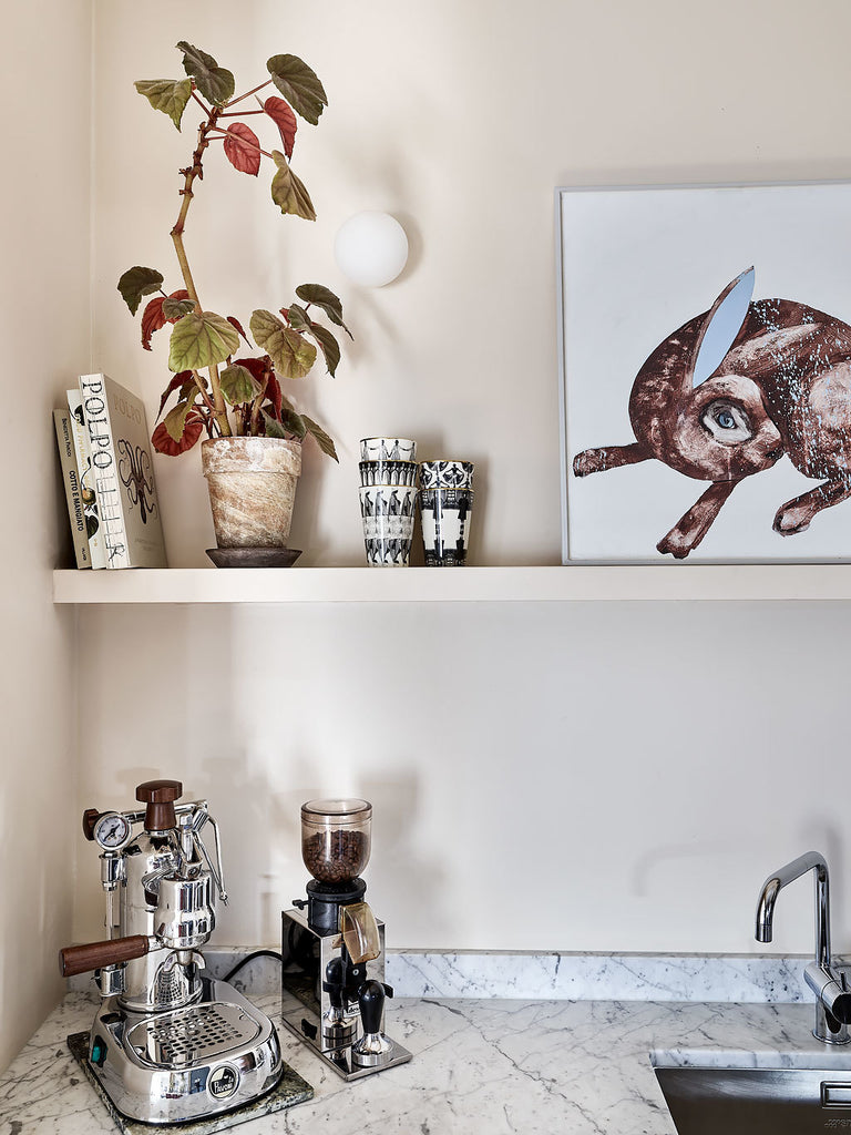 Detail of kitchen in Swedish apt. with traditional and modern mix