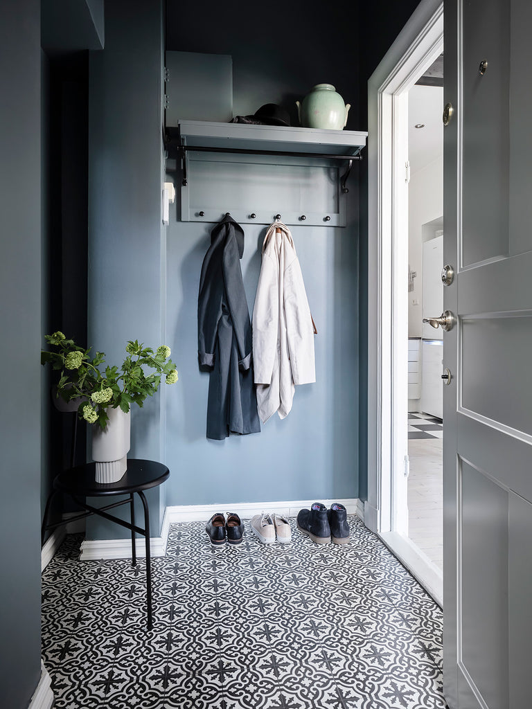 Swedish entryway with beautiful tile floors