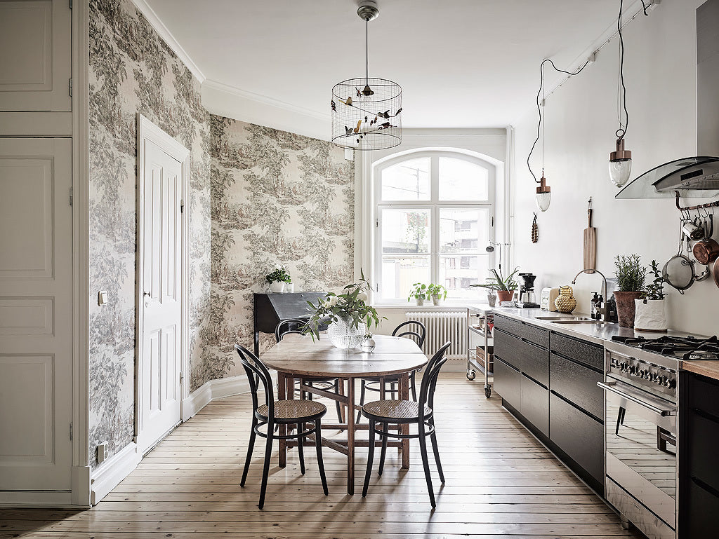 Beautiful kitchen with gorgeous wallpaper in Gothenburg apartment