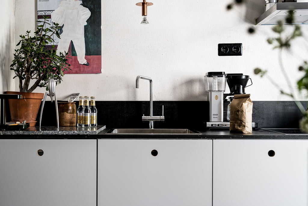 Minimalist kitchen counter in Stockholm apartment