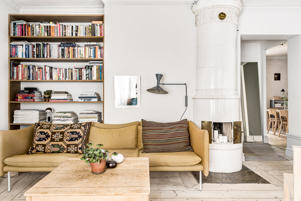 Cozy yellow couch in Stockholm apartment