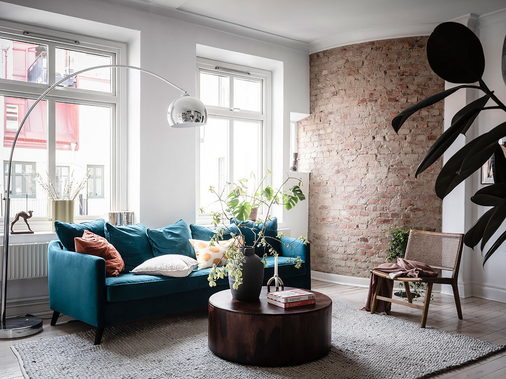 Beautiful blue sofa in Swedish home