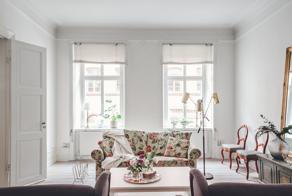 Floral couch in Swedish apartment