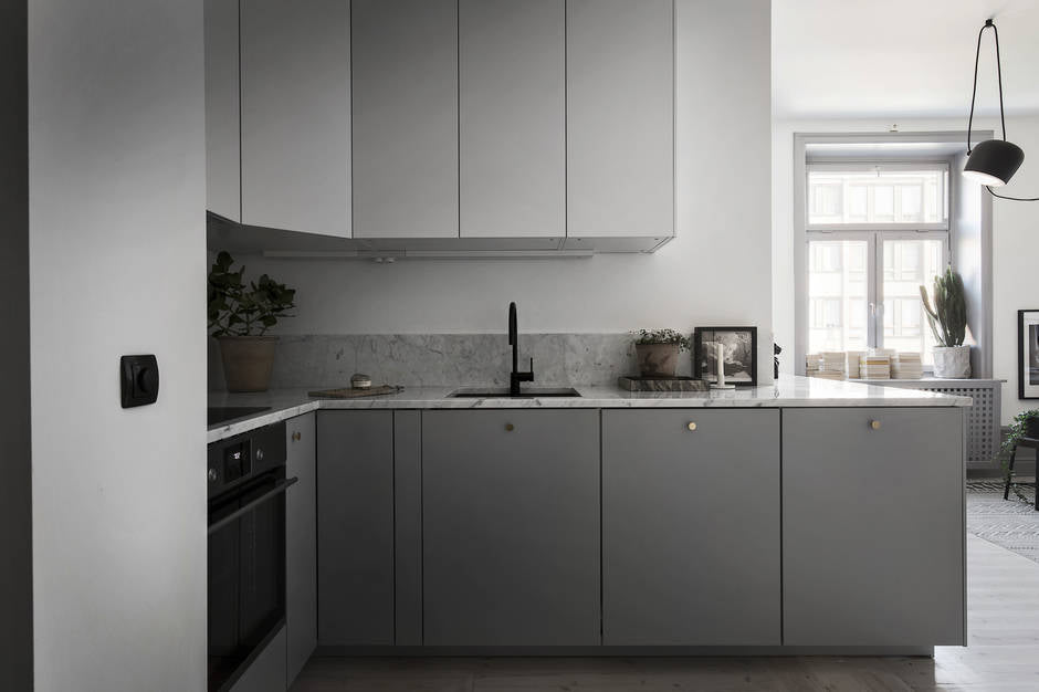 Grey kitchen in Stockholm apartment