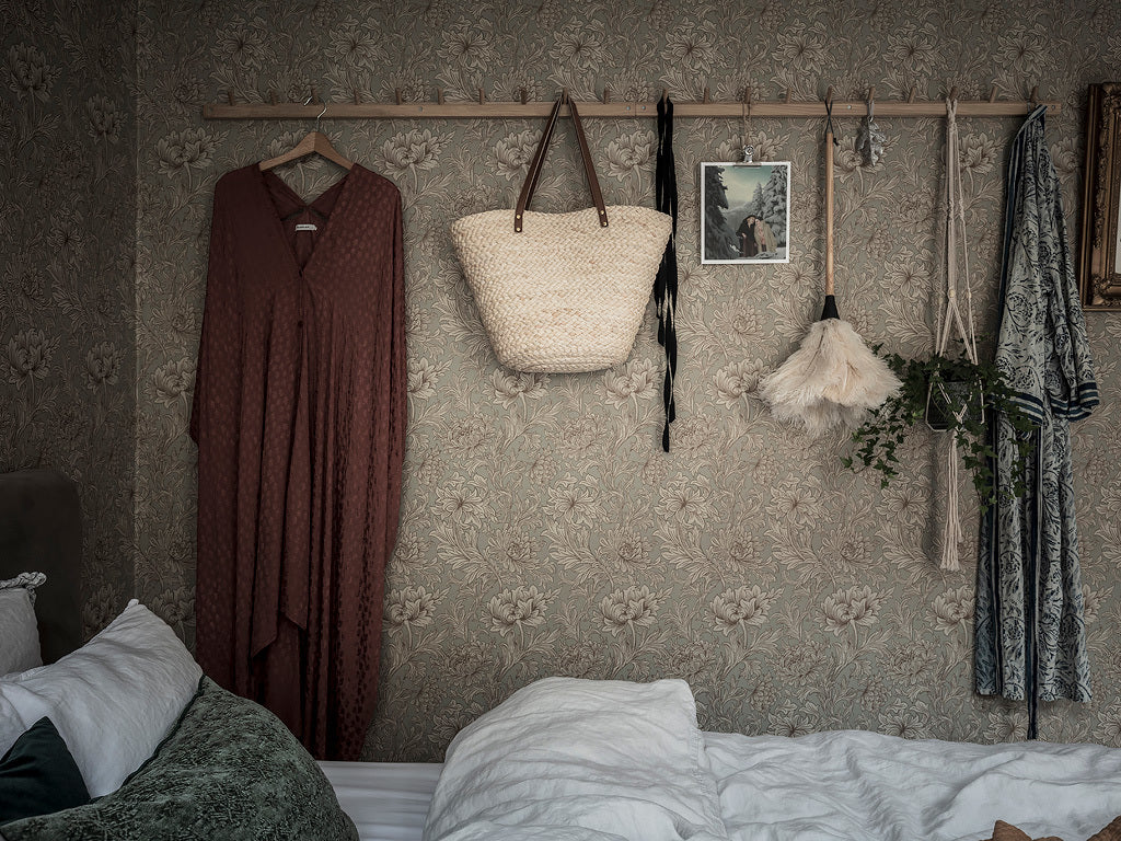 Beautiful wall paper makes Swedish bedroom cosy