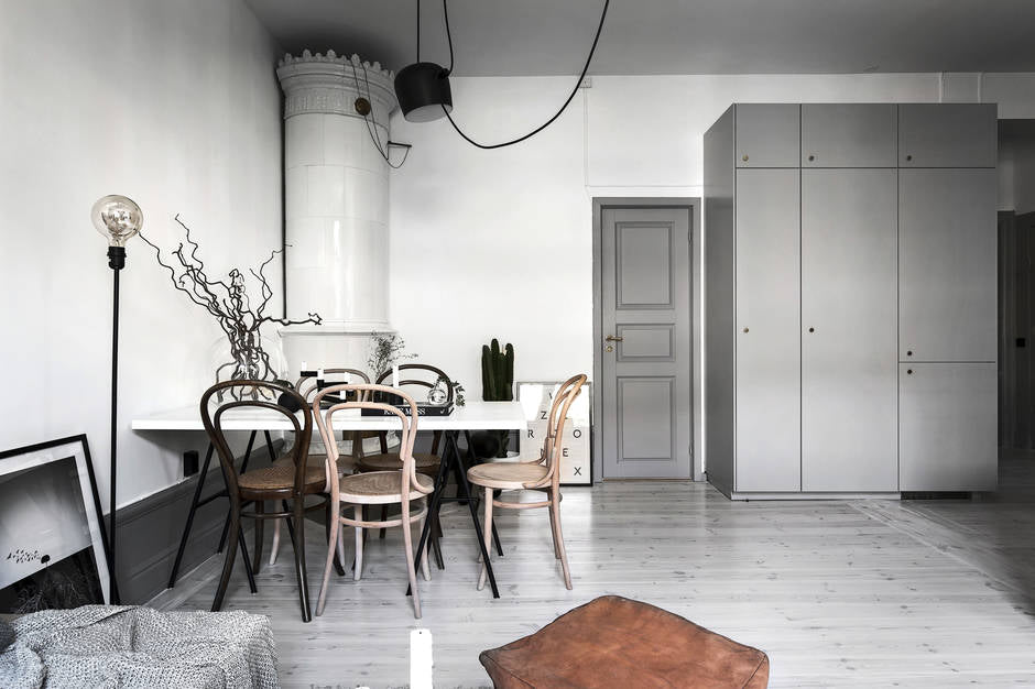 Dining area in grey-hued Swedish apartment