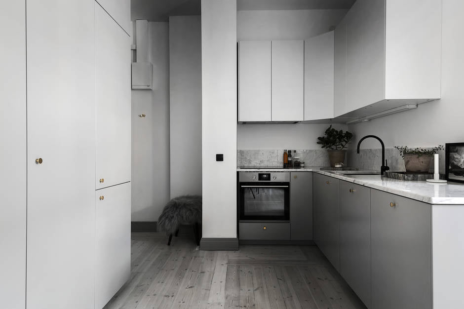 Minimalist kitchen in grey-toned apartment